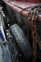 A tractor tyre shields us from the honking great chain