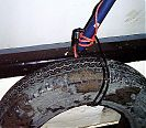 One of the less-critical fenders with a cheap bike cable holding it on