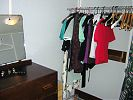 New wardrobe with antique chest of drawers and hanging rail